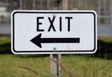 exit sign to represent FTSE quarterly reviewing demoting companies from an index