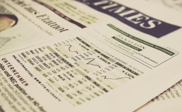 Newspaper showing U.S. stock market indexes